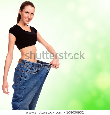 Woman measures her body, white background, copyspace Stock photo © Nobilior