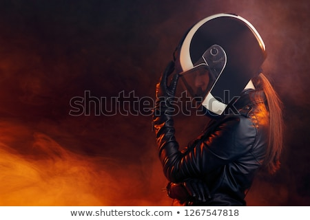 Woman wearing motorsport outfit Stock photo © Anna_Om