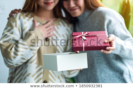 Girl opening gift stock photo © carbouval