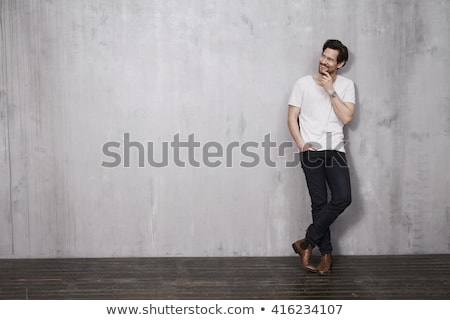casual man with legs crossed and hand in pocket Stock photo © feedough