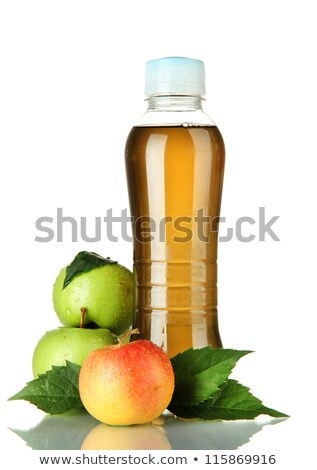 plastic bottles with water and apple with green leaf isolated on stock photo © tetkoren