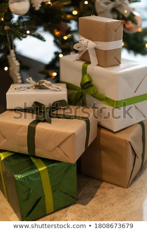 Christmas presents under a holiday tree Stock photo © HASLOO
