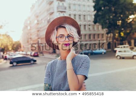 Gyönyörű fiatal szőke lány rövid haj visel Stock fotó © hasloo