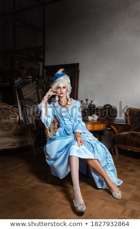 Woman at fashioned dress and renaissance furniture Stock photo © vetdoctor