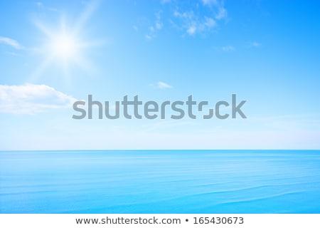 kék · ég · nap · absztrakt · függőleges · fény · kitörés - stock fotó © adamson