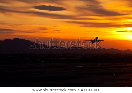 plane flying into phoenix sky harbor stock photo © epstock