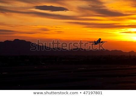 Avião voador phoenix céu porto ensolarado Foto stock © epstock