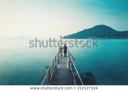 Young Girl at Beach Pier Stock photo © bigandt