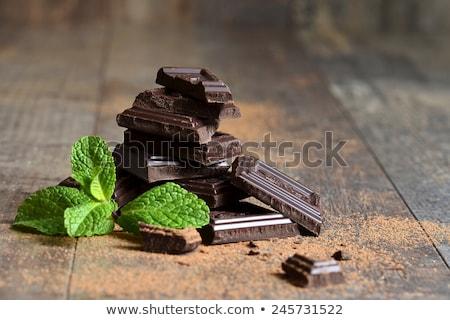 chocolate bars stack and mint leaf stock photo © natika