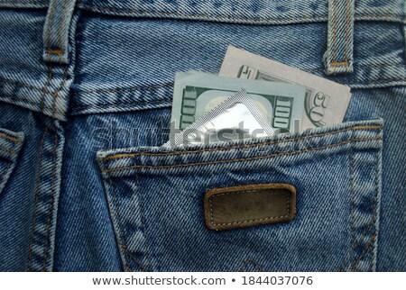 Condoom jeans geïsoleerd weefsel seks Stockfoto © michaklootwijk