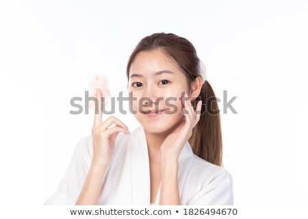 Beautiful young woman removing cosmetics with cleansing pad. Ton Stock photo © Nejron