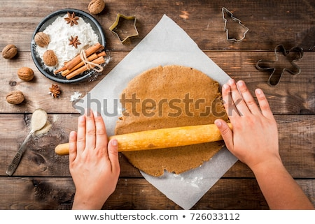 gingerbread dough rolling pin and cookie cutter stock photo © sarahdoow