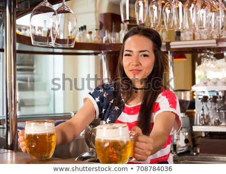 girl serving beer Stock photo © adrenalina