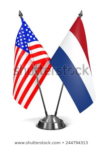 США Нидерланды миниатюрный флагами изолированный белый Сток-фото © tashatuvango