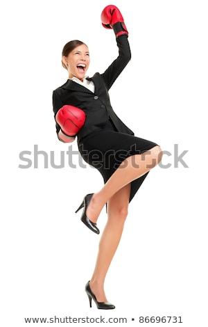 Businesswoman wearing boxing gloves wins Stock photo © cherezoff
