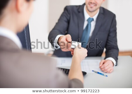 Businessman Giving Visiting Card To Woman Stock photo © AndreyPopov