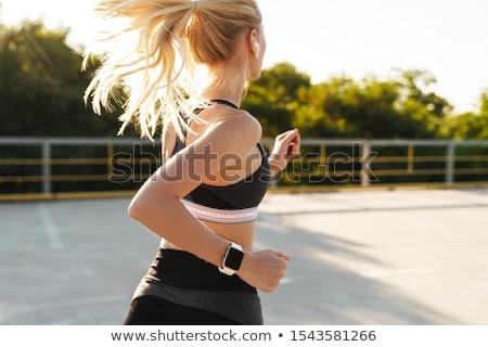 Sarışın kadın egzersiz uygunluk giyim ağırlıklar Stok fotoğraf © Flareimage