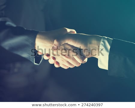 Handshake Handshaking on light and dark Stock photo © adamr