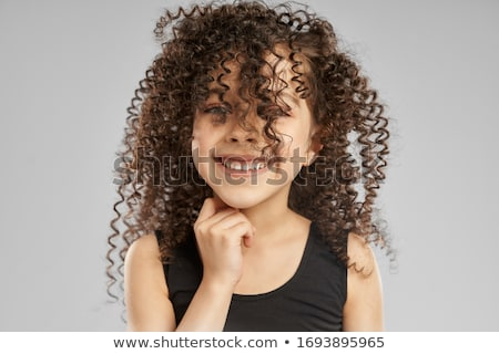 pretty curly brunette stock photo © acidgrey