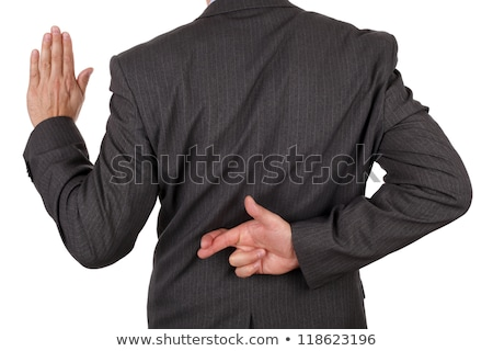 Rear view of a businessman with fingers crossed Stock photo © imagedb