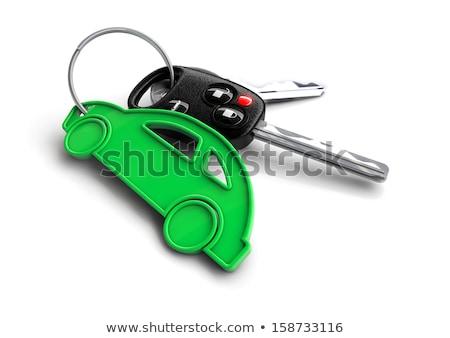 Car keys with orange passenger vehicle icon as keyring. stock photo © crashtackle