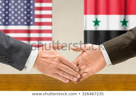 Representatives of the USA and Syria shake hands Stock photo © Zerbor