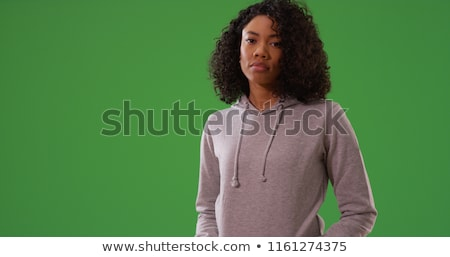 Stock photo: Composite image of upset woman looking at camera