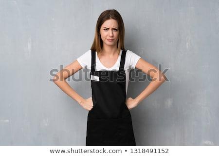 Boos serveerster naar rommelig gerechten vloer Stockfoto © x7vector
