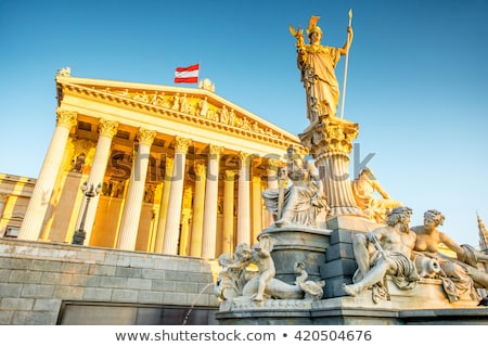 the austrian parliament and statue of pallas athena in vienna a stock photo © vladacanon