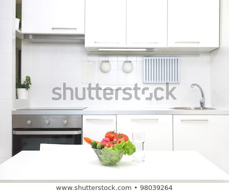 Small white coloured kitchen Stock photo © jrstock