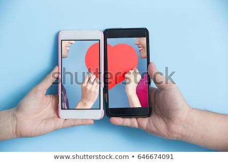 Romantik mesaj genç kadın okuma dijital tablet Stok fotoğraf © filipw