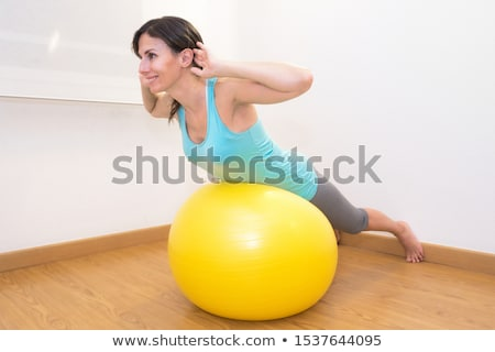 the young beautiful sports girl doing exercises on a fitball stock photo © master1305