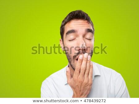 Young businessman yawning Stock photo © deandrobot