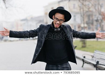 young stylish guy in park posing stock photo © zurijeta