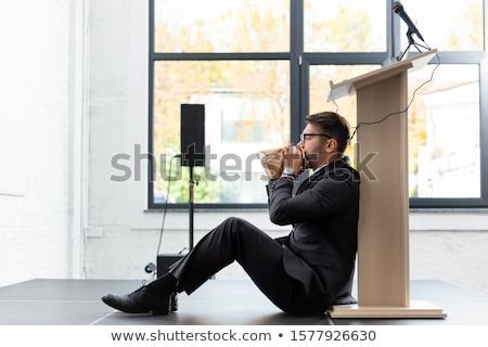 怖い 男 座って 会議 ホール カジュアル ストックフォト © deandrobot