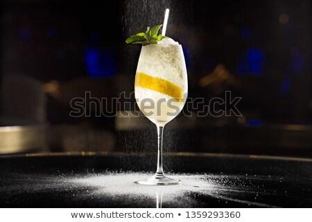Glass of champagne with lemon slice Stock photo © cherezoff