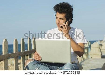ストックフォト: 若い男 · ラップトップを使用して · ビーチ · 座って · セクシー · 幸せ