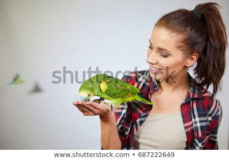Girl holding a talking bird Stock photo © bluering