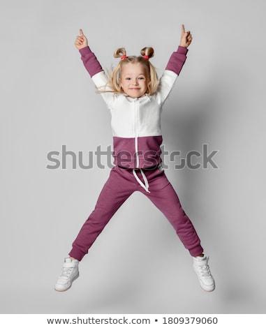 Kislány testmozgás öltöny ugrik illusztráció gyermek Stock fotó © bluering