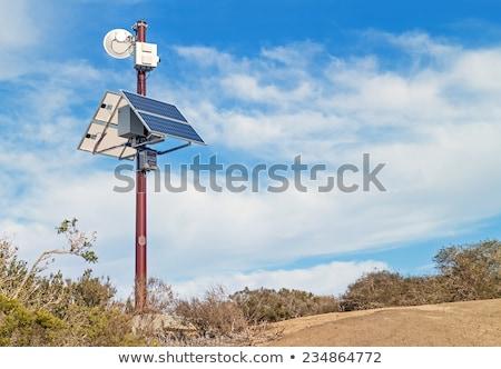 Surveillance Camera with Solar Power blue sky as background Stock photo © smuki