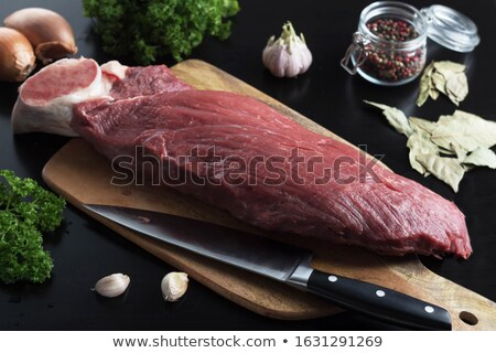 The cook cuts boiled beef meat Stock photo © grafvision