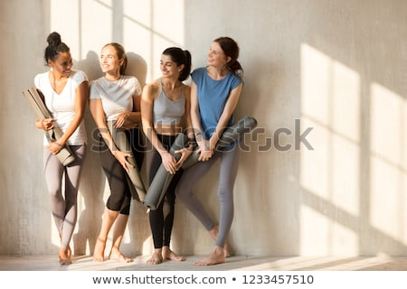 group of multicultural young people practicing yoga stock photo © deandrobot