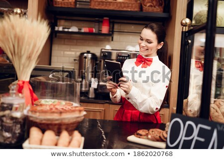 Young girl at kitchen counter looking at cake smiling Stock photo © monkey_business