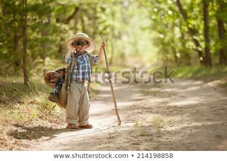 Boy looking through binoculars in the forest Stock photo © wavebreak_media