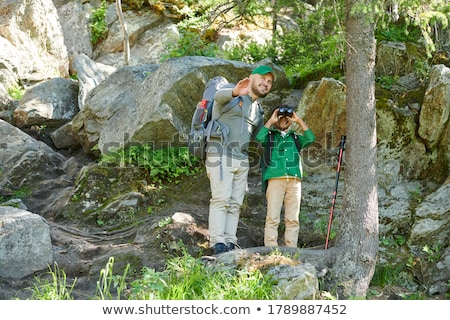 boy looking through binoculars and pointing in the forest stock photo © wavebreak_media