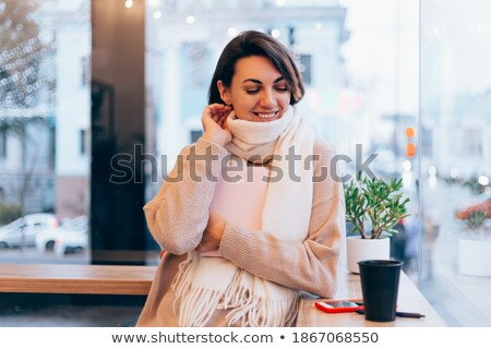 Pensive cute girl sitting at the cafeteria and looking away Stock photo © deandrobot