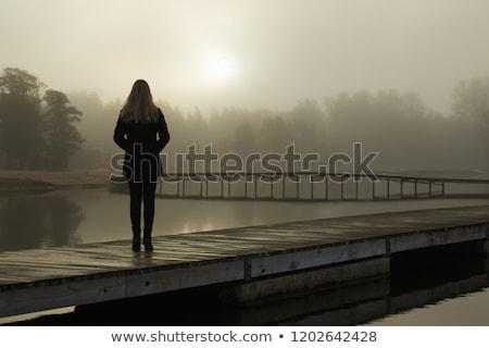 Triste mulher em pé lago nostálgico Foto stock © stevanovicigor