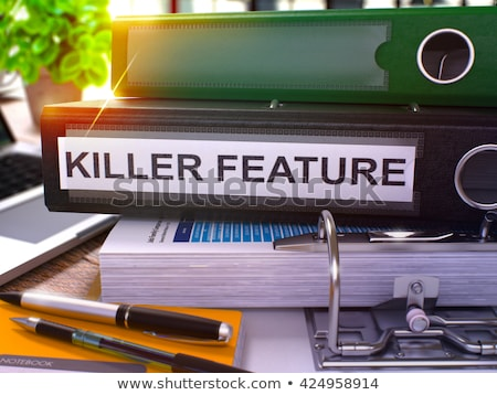 Stock photo: Killer Feature on Binder. Blurred Image. 3D