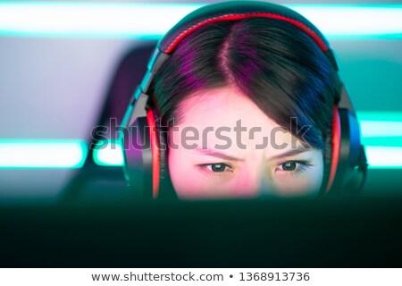 közelkép · mosolyog · fiatal · lány · zenét · hallgat · fülhallgató · pihen - stock fotó © deandrobot