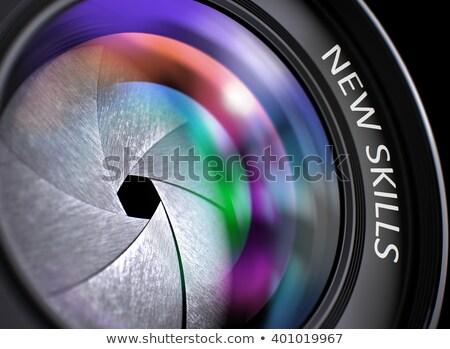 Lens digitale camera opschrift nieuwe vaardigheden gekleurd Stockfoto © tashatuvango